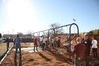 Mulch was spread across the playground at City Park Elementary during a service day for Flight, Vogel Alcove's Young Professionals Organization, on Jan. 20. The nonprofit was able to save several thousand dollars by having volunteers help with the mulching.Photo by REN MORRISON