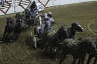 Chuck wagon drivers Blaid Flad (right) of Alberta, Canada, and Warren Burns of Melfort, Canada, rounded the bend Thursday in Fort Worth.