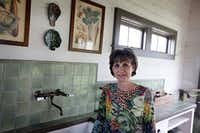 Jody Bowers stands in the conservatory of her Swiss Avenue home.