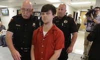 Tarrant County sheriff's deputies escorted Ethan Couch to Friday morning's hearing in Fort Worth. (LM Otero/The Associated Press)