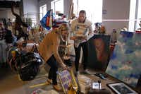 Thrift Studio Sarah Brannon (left) and Katherine Adams with Jan Showers & Assoc. gather pieces they found in the Dwell With Dignity warehouse of donated goods.Evans Caglage  -  Staff Photographer
