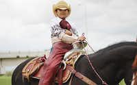 Madeleine Guerra, 9, likes to dress in full cowboy gear when she rides horses with her family on the Trinity River levees near downtown Dallas.