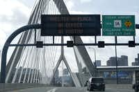 "An electronic highway message board n on I-93 near the Zakim Bridge in Boston warns people to ""shelter in place"" Friday morning due to the manhunt for the second suspect in Monday's bombings. Authorities were looking for  Dzhokhar Tsarnaev, whose older brother Tamerlan was killed in a clash with police early Friday morning.Elise Amendola - The Associated Press"