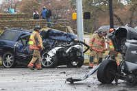 Emergency workers investigate the scene of a multicar accident and shooting on Dec. 14, 2011, at North Collins Street and Brown Boulelvard in Arlington. The driver of the blue SUV, Thomas Lester Harper, is on trial for the fatal shooting of a good Samaritan after the wreck and has been indicted in the death of the driver of the pickup seen at right.File 2011 - Telegram