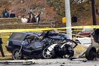 Onlookers survey the scene of a Dec. 14, 2011, crash in north Arlington that left two people dead: the driver of the vehicle at right and a good Samaritan shot while approaching the blue SUV. Thomas Lester Harper, who was driving the SUV, is on trial for the shooting death and has been indicted in the pickup driver's death as well.File 2011 - Staff Photo