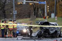 Arlington firefighters look on as an investigator examines the wreckage of a Dodge pickup at the scene of a fatal accident and shooting on Dec. 14, 2011, in north Arlington. The pickup's driver was killed, and the man accused of causing the crash, Thomas Lester Harper, is on trial for the shooting death of a good Samaritan at the scene.Fiile 2011 - Staff Photo