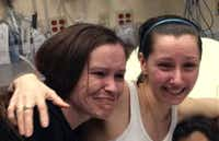 Amanda Berry (right) hugs her sister Beth Serrano after they were reunited Monday in a Cleveland hospital. Berry, who had been missing for 10 years, and two other women were found in and rescued from a house near downtown Cleveland.WOIO-TV - The Associated Press