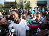 Charles Ramsey, the neighbor who first responded to Amanda Berry's cries for help, speaks to media near the home on the 2200 block of Seymour Avenue in Cleveland, where Berry and two other women who had been missing since the early 2000s were rescued Monday.Scott Shaw - The Plain Dealer