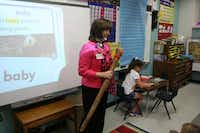 Pam Taylor gets her students' attention with a rain stick near the end of an instructional period at Garden Ridge Elementary. Taylor has taught at the school for 19 years of her 36-year teaching career.Staff photo by DANIEL HOUSTON  -  neighborsgo