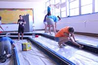 Volunteers from the Village Church and surrounding community help to resurface parts of the former choir room.