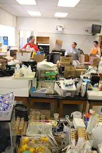 """One big project was to do all of the inventory for the school's science department. """"This is a job that no one wants to do, but it's a great help,"""" chair of the science department Brett Davis told his volunteers."""