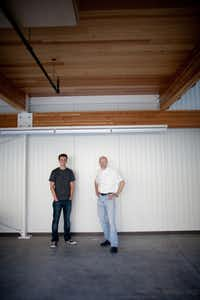 By design: Architect Russell Buchanan (right) and project architect Troy Carlson in the home's central living space.
