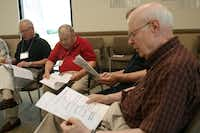Jerry McMahan reads along with other group members for a vocal exercise during a Loud Crowd session at the Parkinson Voice Project's new facility off Coit Road. Loud Crowd is the voice maintenance program that follows the four-week speech therapy program called Speak Out.
