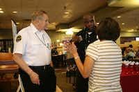 Lopez (right front) talks with Neighborhood police officer Bervin Smith at the breakfast.HEATHER NOEL - neighborsgo staff