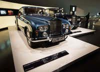 A 1964 Rolls Royce Silver Cloud III (foreground) and a 1966 Phantom V stand side by side in an exhibit room.