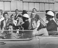 President John F. Kennedy and first lady Jacqueline Kennedy in the motorcade before the assassination. Gov. and Mrs. John Connally rode in the front seat.