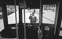 Kenneth Hutchison, a motorman for the McKinney Avenue trolley, switches a streetcar's direction at the CityPlace stop.