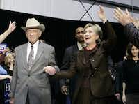 Former U.S. Rep. Jack Brooks (left) escorts Hillary Rodham Clinton to the stage at the Beaumont, Texas, airport  during a March 2008 campaign stop for Clinton's bid for the Democratic presidential nomination. Brooks, who spent 42 years representing his Southeast Texas district in Congress, died Tuesday at age 89.