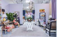 Mecox Designers relied on a pastel palette repeated in orchids and hydrangeas to create an elegant, feminine room. Like all Thrift Studio designers, at least half of the items in Mecox's vignette came from Dwell With Dignity's warehouse of donated goods. Mecox gave new life to a tired table with high-shine white lacquer paint.Lance Selgo  -  Unique Exposure Photography