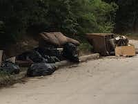 Illegal dumping in the 10th street Historic District at the corner of 10th and Cliff streets.Leona Allen/Dallas Morning News