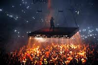 Kanye West sang on a stage that hovered over the crowd during his performance Thursday at American Airlines Center in Dallas. (Ben Torres/Special Contributor)