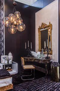 Tompkins Lloyd Interiors<252>The team's Dwell With Dignity space is a luxe bedroom that plays up a glamorous '70s vibe. Big gold mirrors are trendy today, too.Lance Selgo - Unique Exposure Photography