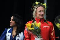 Olympic medal winner Deena Kastor, who finished first in the women's division with a time of 1:11:57, is honored onstage during the Dallas Rock N' Roll half-marathon on Sunday, March 23, 2014. (Matthew Busch/The Dallas Morning News)Matthew Busch - Staff Photographer
