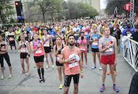 Runners listen as the national anthem is played before the start of the Dallas Rock N' Roll half-marathon on Sunday, March 23, 2014. (Matthew Busch/The Dallas Morning News)Matthew Busch - Staff Photographer