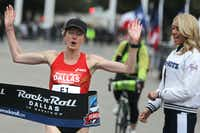 Olympic medal winner Deena Kastor finished first in the women's division with a time of 1:11:57 during the Dallas Rock N' Roll half-marathon on Sunday, March 23, 2014. (Matthew Busch/The Dallas Morning News)Matthew Busch - Staff Photographer