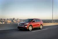 The 2013 Hyundai Santa Fe Limited has three rows of seats and 80 cubic feet of interior space.