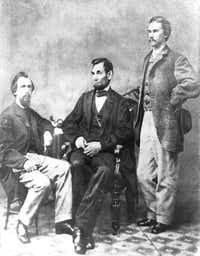 """Photo shows President Abraham Lincoln seated between his private secretaries John G. Nicolay (left) and John Hay at a photo session in Alexander Gardner's studio in Washington, D.C., on November 8, 1863. """"On this day John Hay wrote in his diary: 'Went with Mrs. Ames to Gardner's Gallery & were soon joined by Nico (John G. Nicolay) and the Prest. We had a great many pictures taken ... some of the Prest. the best I have seen. ... Nico & I immortalized ourselves by having ourselves done in a group with the Prest."""""""