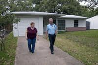 Shirley Smith (left), capital improvement program coordinator for the city of Irving, and city archivist Kevin Kendro walk outside the Ruth Paine House Museum.Photo by REX C. CURRY