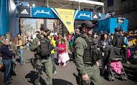 Special Operations Transit Police patrolled the finish line of the Boston Marathon on Sunday. Last year two explosions near the finish line killed three and wounded 264 others. The usually rigorous entry process for the race this year was widened to include runners touched by the tragedy.Andrew Burton  -  Getty Images