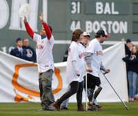 Carlos Arredondo, a first responder during the bombing, and survivors attended a ceremony Sunday at Fenway Park before a game between the Red Sox and the Orioles.Jim Rogash  -  Getty Images