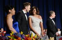 WASHINGTON, DC - MAY 3:  First lady Michelle Obama and Comedian Joel Mchale share a laugh on stage at the annual White House Correspondent's Association Gala at the Washington Hilton hotel May 3, 2014 in Washington, D.C. The dinner is an annual event attended by journalists, politicians and celebrities. (Photo by Olivier Douliery-Pool/Getty Images)Pool - Getty Images