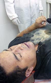 After the Mexican navy released this photo of the corpse to newspapers Tuesday, saying it had been confirmed as Heriberto Lazcano Lazcano, websites were flooded with readers questioning whether it was him.