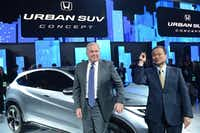 Honda Motor Company President and CEO Takanobu Ito (R) and John Mendel, American Honda Executive Vice President of Auto Sales, introduce the Honda Urban SUV concept car at the 2013 North American International Auto Show in Detroit, Michigan, on January 14, 2013.   AFP PHOTO/Stan HONDASTAN HONDA/AFP/Getty ImagesSTAN HONDA - AFP/Getty Images