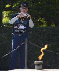 A tourist photographs the gravesite and eternal flame at the memorial of US President John F. Kennedy and First Lady Jacqueline Kennedy Onassis, at Arlington National Cemetery in Arlington, Virginia, September 24, 2013. November 22 marks the 50th anniversary of Kennedy's assassination during a visit to Dallas, Texas, in 1963.