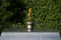An eternal flame is lit at the gravesite memorial of former US President John F. Kennedy and First Lady Jacqueline Kennedy Onassis, at Arlington National Cemetery in Arlington, Virginia, September 24, 2013. November 22 marks the 50th anniversary of Kennedy's assassination during a visit to Dallas, Texas, in 1963.