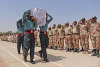 Members of Pakistan's elite paramilitary Rangers carry the coffin of a colleague killed in the Taliban's assault on Karachi's Jinnah International Airport. Nineteen people died, in addition to the 10 attackers, in the five-hour attack.Rizwan Tabassum  - Presse