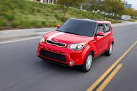 The 2014 Kia Soul features large, swept-back headlamps, a short, flat hood and a big blacked-out lower grille.
