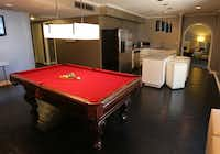 One of the updated rooms features a pool table. HD TVs also were added, as were desks with extra electrical outlets.