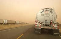 Blowing dust and wind speeds averaging 45 mph and gusting to 55 mph hampered drivers on Interstate 27 near Lubbock, Tex., on Wednesday, December 19, 2012.Ariel Kirkland - Journal