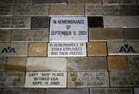 Names of flight crew members killed during the 9/11 attacks are etched into bricks on the floor of the C.R. Smith Museum in Fort Worth.