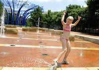 Kids can play in the fountains at Addison Circle ParkCody Duty - AP