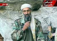 ORG XMIT: S0369775597_WIRE Osama bin Laden is seen at an undisclosed location in this television image broadcast Sunday Oct. 7, 2001. Bin Laden praised God for the Sept. 11 terrorist attacks and swore America 'will never dream of security' until 'the infidel's armies leave the land of Muhammad,' in a videotaped statement aired after the strike launched Sunday by the United States and Britain against Afghanistan.