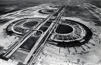With construction underway in 1973, architect Gyo Obata's vision of a series of semicircular terminals astride a central spine began to take shape.File/Staff Photo
