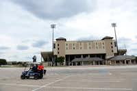 Members of the Balding Eagles Booster Club James Adams, Nolan Srader and Mark Kapocsi ride their Allen Eagle golf cart across the parking lot at Plano ISD's John Clark Stadium. The Allen football team will play at Plano ISD's stadiums this year, including John Clark Stadium.Rose Baca