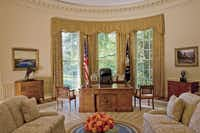 The Oval Office inside the White House as seen in the March 2008 issue of Architectural Digest. First lady Laura Bush began redecorating after President Bush took office in 2001, with consultation from the White House curatorial staff and Kenneth Blasingame, a Texas designer who had been involved in the interior design of the couple's Dallas houses, the Crawford ranch, Camp David and public-private rooms in the Bush Center.