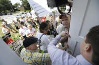 Protestors try to enter the Republican Party of Iowa headquarters before an appearance by U.S. Sen. Ted Cruz, R-Texas, at a fundraising picnic for the Iowa Republican Party, Friday, July 19, 2013, in Des Moines, Iowa. (AP Photo/Charlie Neibergall)Charlie Neibergall - AP